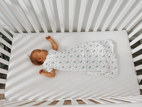 Baby wearing baby products for sleeping