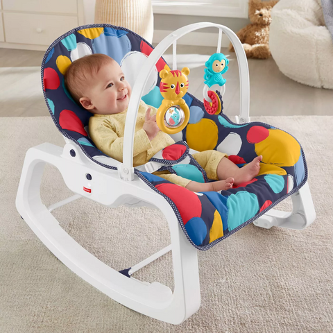 Baby playing in baby rocker