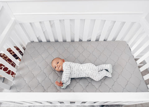 baby rolling over in crib