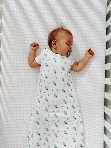 Baby wearing a swaddle blanket for baby safety