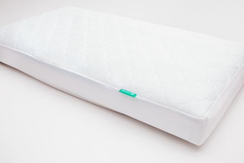 a mattress pad is a practical baby shower gift idea