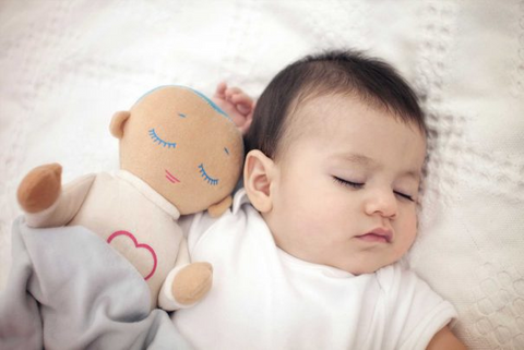 baby sleeping with Lulla Doll