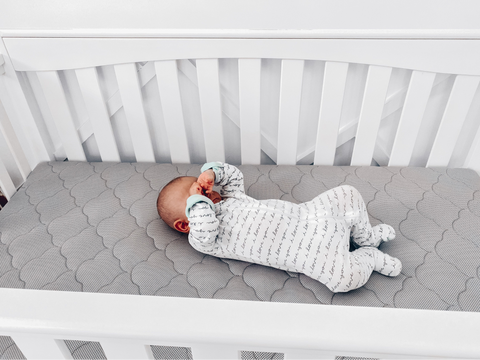 tired baby in crib that wont nap