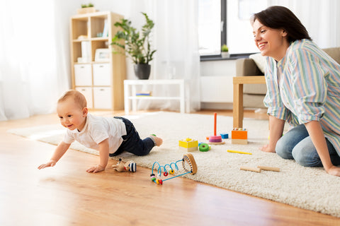 mom playing with son after babyproofing house