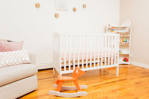 baby room with crib and rocking horse