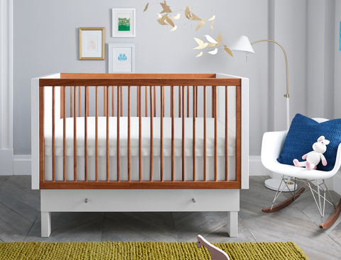 brown and white crib in baby room