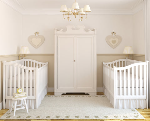 Two cribs for twins in nursery