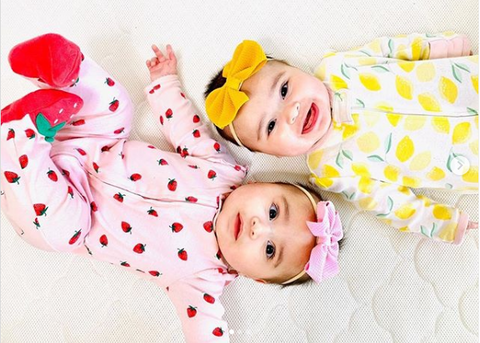 twin baby girls laying together