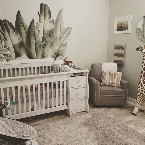 Nursery with crib with changing table