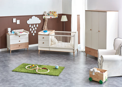 crib with changing table in nursery