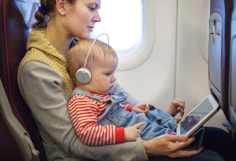 Mom entertaining while flying with a baby