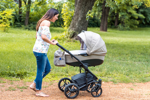 mom out on a walk with fussy baby