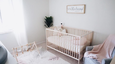 a minimalist gender-neutral nursery with muted earth tones