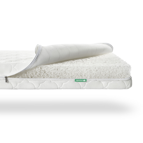newton baby crib mattress with a white mattress cover