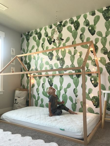 example of colorful gender-neutral nursery ideas with cactus wallpaper