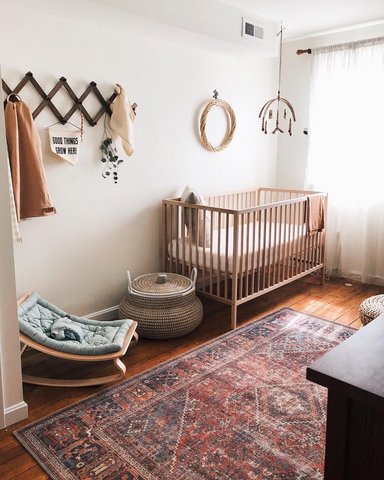 a minimalist gender-neutral nursery featuring wicker and wood accents