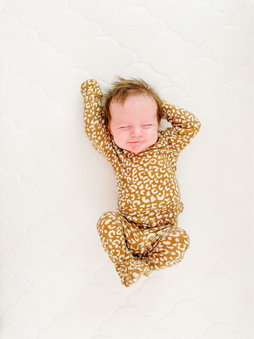 baby stretching in cute baby pajamas