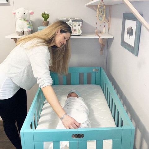 mom learning how to get baby to sleep in crib