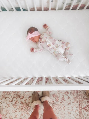 parents figured out how to get baby to sleep in crib