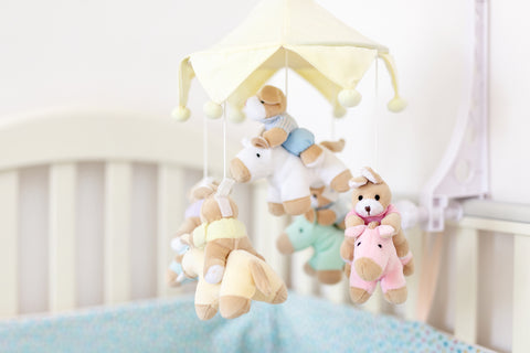 a baby mobile in a crib