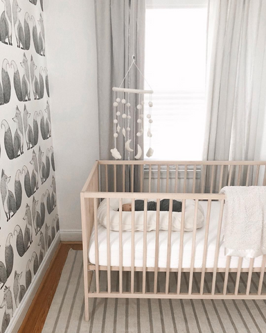 nursery with mobile over crib