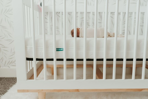 Sleeping baby in minimalist crib