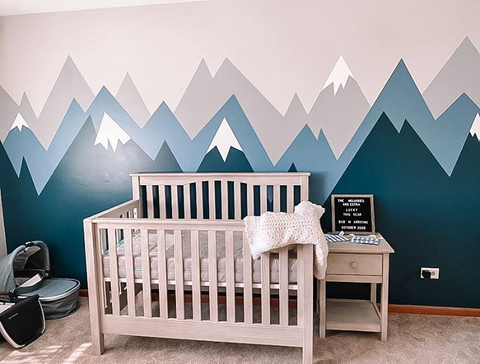 modern nursery idea with painted blue and grey mountains on wall