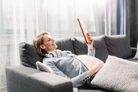 Pregnant woman having a self care day while nesting