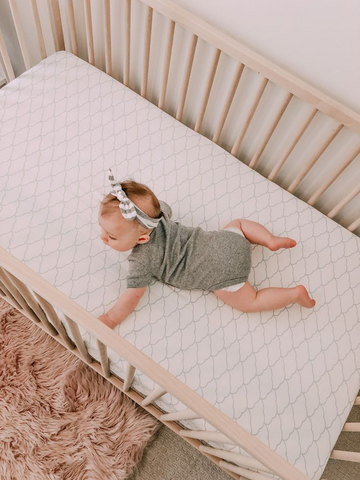 Baby crawling in crib