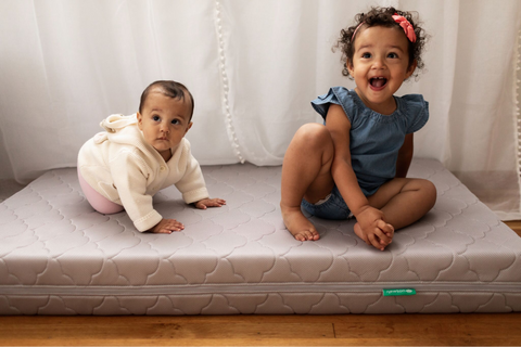 two babies on a Newton Baby crib mattress