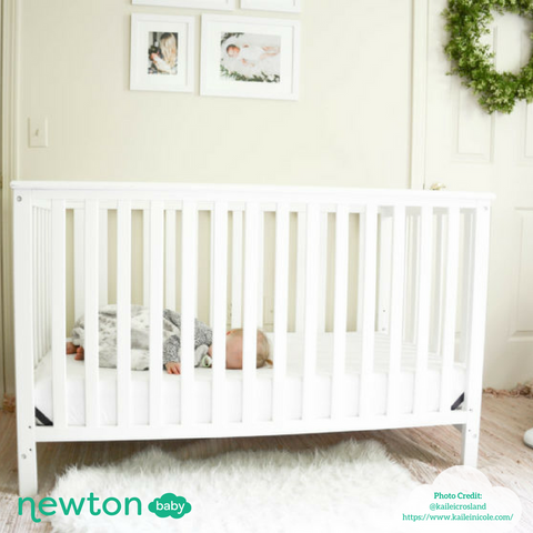 baby sleeping in crib in nursery