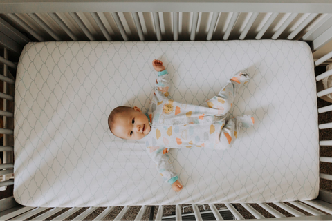baby laying in a crib