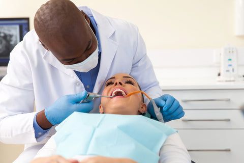 woman in second trimester getting a dental exam