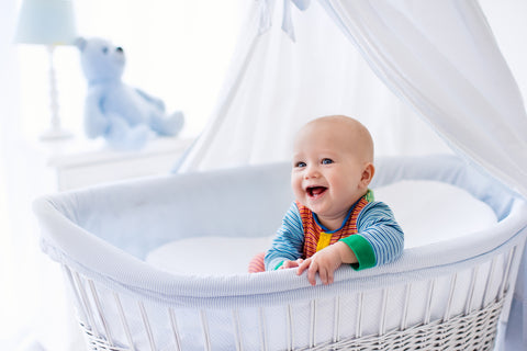 happy baby in bassinet