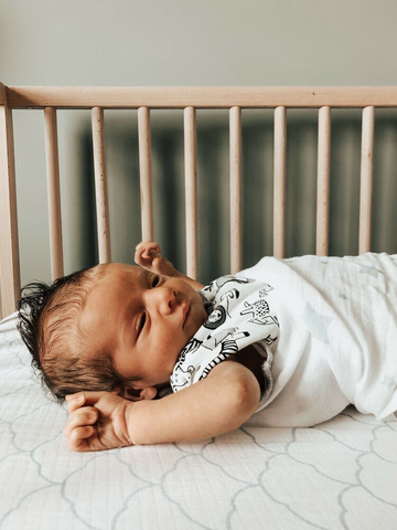 baby stretching out of swaddle