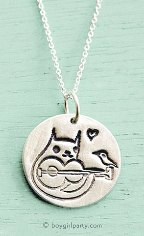 Silver Cat Necklace by Susie Ghahremani | Source: shop.boygirlparty.com
