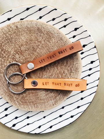 · LET THAT SHIT GO LEATHER KEYCHAIN ·
