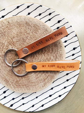 · KIDS HAVE PAWS LEATHER KEYCHAIN ·