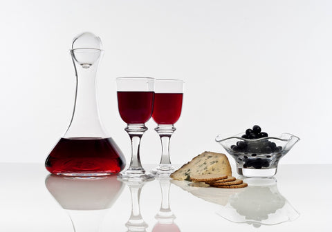 Picture of a wine decanter and two clear short stem wine glasses