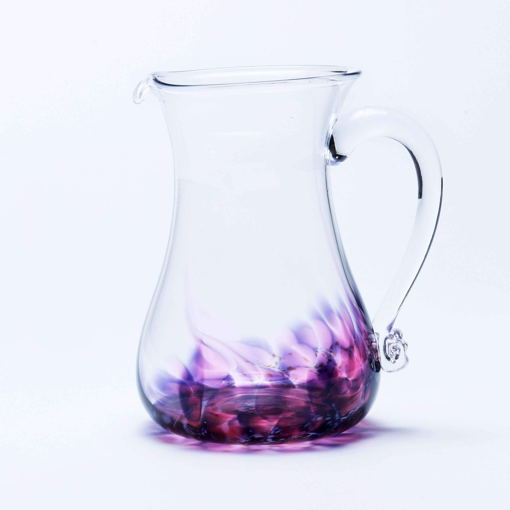 Large handmade round glass jug in berry