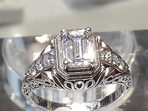 "Diamond Ring ""The Empress"" Vintage design shown with 1.00 carat G.I.A. certified Emerald cut Diamond. VS1-clarity, I in color. Accent Diamonds:  SI1-clarity, G-H in color."