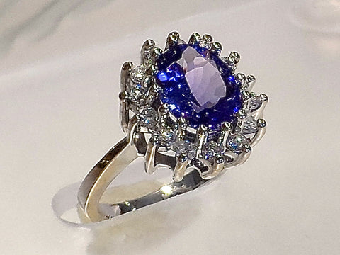 Tanzanite and Diamond ring in a classic design,set in 14k. white gold. Tanzanite (2.29carat) surrounded by 14 round Brilliant cut Diamonds.