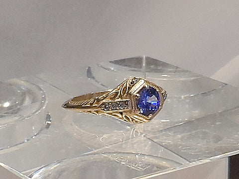 """The Princess"" Vintage design set with a natural  blue-violet Sapphire in 14k. yellow gold with six  1.3mm. full cut Diamonds   .06ct. Diamond weight."
