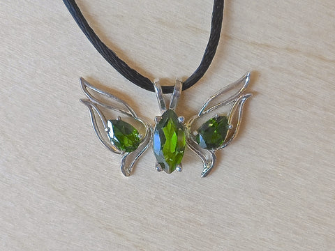 Chrome Diopside Butterfly set in Sterling Silver. One 10x5mm. Marquise and two 6x4 Pear shapes intense green Chrome Diopside 2carat total weight.