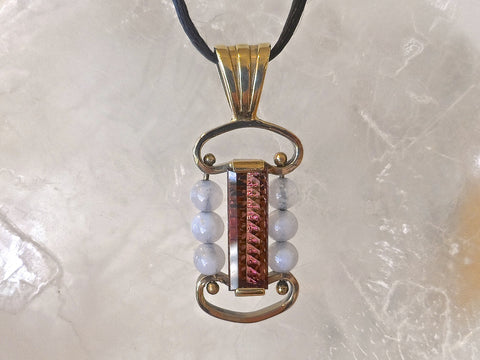 Pink Tourmaline and blue lace Agate pendant set in 14k. two-tone gold. 4.5carat Millennium cut Pink Tourmaline and 6 blue lace Agate beads.