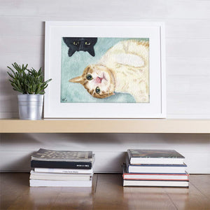 watercolor painting of 2 pet cats in a frame on a shelf about some book stacks