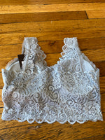 Lace bralette with scalloped edges and removable padding