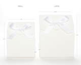 Lux Party's small white favor box and large white favor box, side by side, showing dimensions of each.