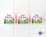 Three pink favor boxes with square personalized cactus baby shower stickers affixed. Lux Party logo.