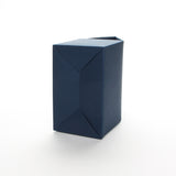 Bottom view of Lux Party's navy blue favor box on a white background.